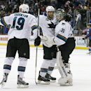 From left, San Jose Sharks center Joe Thornton joins left wing James Sheppard in congratulating goalie Antti Niemi, of Finland, after he stopped the shot off the stick of Colorado Avalanche center Matt Duchene, back, to seal the Sharks' 3-2 shootout victo