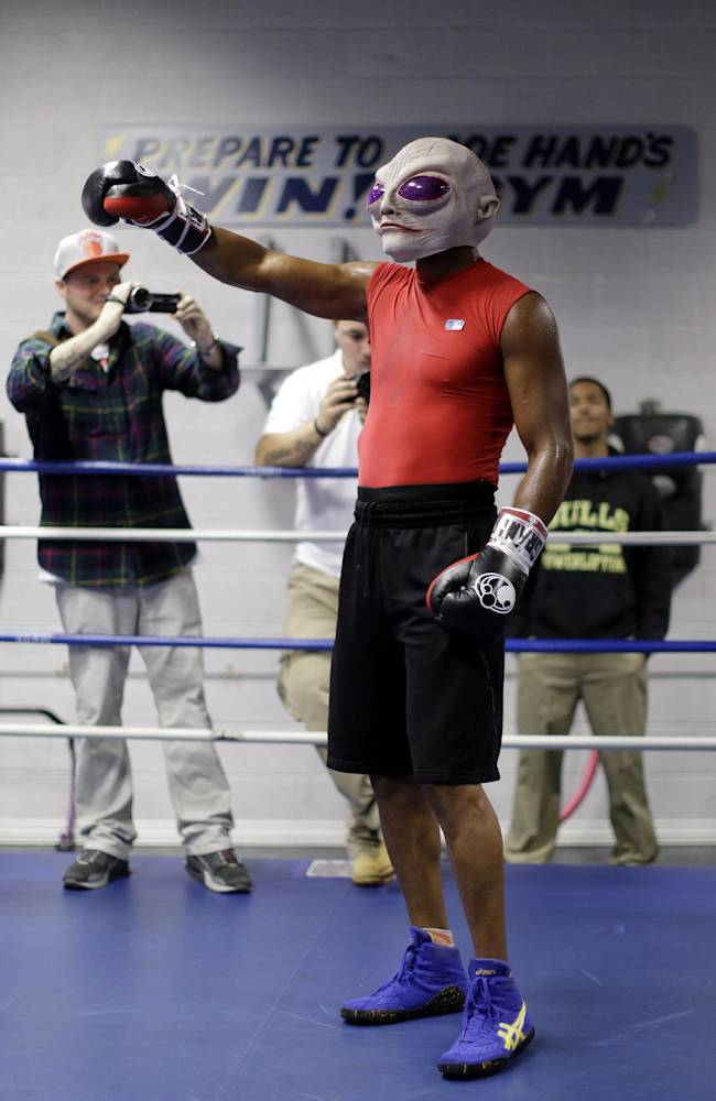 Boxer Bernard Hopkins wears an alien mask during a media workout Wednesday, Oct. 16, 2013, in Philadelphia. Hopkins is scheduled to fight Karo Murat at Boardwalk Hall in Atlantic City, N.J., on Oct. 26