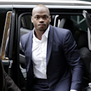 Minnesota Vikings' Adrian Peterson arrives for a hearing for the appeal of his suspension in New York, Tuesday, Dec. 2, 2014. (AP Photo/Seth Wenig)
