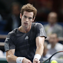 Andy Murray of Britain, returns to Grigor Dimitrov of Bulgaria during their third round match at the ATP World Tour Masters tennis tournament at Bercy stadium in Paris, France, Thursday, Oct. 30, 2014. Murray won 6-3, 6-3. (AP Photo/Michel Euler)