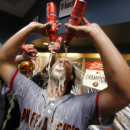 San Francisco Giants starting pitcher Madison Bumgarner celebrates after pitching the Giants to an 8-0 win over the Pittsburgh Pirates in the National League wild-card playoff baseball game in Pittsburgh on Wednesday, Oct. 1, 2014. (AP Photo/Gene J. Puskar)
