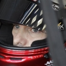 Driver Jeff Gordon looks from his car before practice for Saturday's NASCAR Bank of America 500 Sprint Cup series auto race in Concord, N.C., Friday, Oct. 12, 2012. (AP Photo/Chuck Burton)