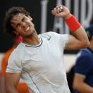 Spain's Rafael Nadal celebrates after defeating Czech Republic's Tomas Berdych during their semi final match at the Italian Open tennis tournament in Rome, Saturday, May 18, 2013. Nadal won 6-2, 6-4. (AP Photo/Andrew Medichini)