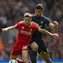 Liverpool's Jordan Henderson, left, against Southampton's Graziano Pelle during their English Premier League soccer match at Anfield Stadium, Liverpool, England, Sunday Aug. 17, 2014