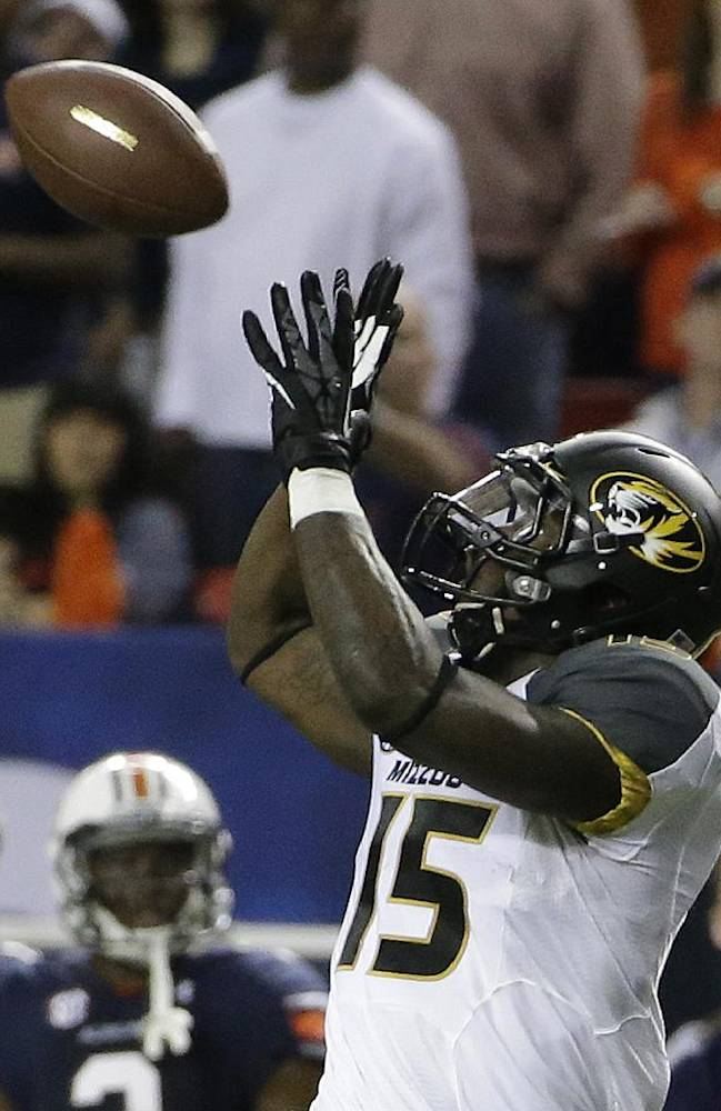 Missouri wide receiver Dorial Green-Beckham (15) makes a catch against Auburn during the first half of the Southeastern Conference NCAA football championship game, Saturday, Dec. 7, 2013, in Atlanta. Green-Beckham scored a touchdown on the play