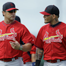 St. Louis Cardinals manager Mike Matheny, left, talks with catcher Yadier Molina during spring training baseball practice Thursday, Feb. 20, 2014, in Jupiter, Fla The Associated Press