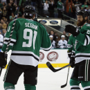 Dallas Stars' Tyler Seguin (91) is congratulated by Jordie Benn (24) after Seguin scored his second goal in the first period of an NHL hockey game against the San Jose Sharks, Saturday, Nov. 8, 2014, in Dallas The Associated Press