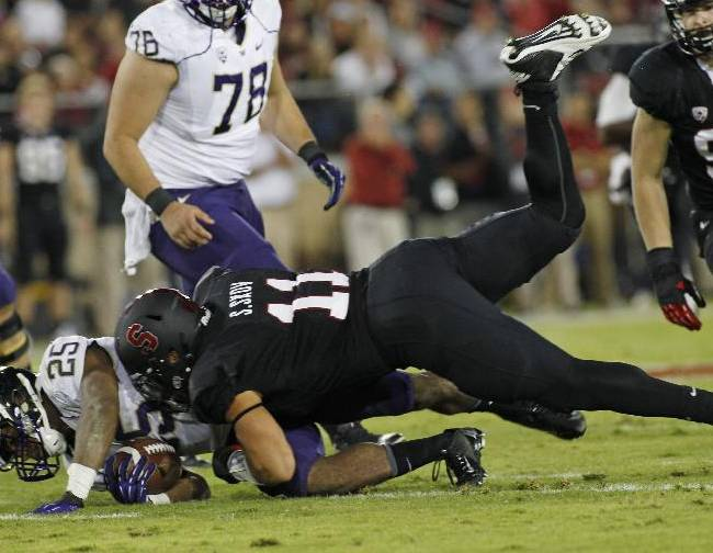 Stanford's Shayne Skov, top, tackles Washington's Sankey Bishop during the first half of an NCAA college football game in Stanford, Calif., Saturday, Oct. 5, 2013