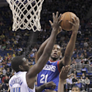 Philadelphia 76ers' Thaddeus Young (21) makes a shot over Orlando Magic's Andrew Nicholson (44) during the second half of an NBA basketball game in Orlando, Fla., Wednesday, Nov. 27, 2013. Orlando won the game 105-94 The Associated Press