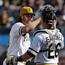 Pittsburgh Pirates closer Jason Grilli, left, celebrates with catcher Tony Sanchez (26) after getting the final out of the ninth inning to end a baseball game against the St. Louis Cardinals in Pittsburgh, Sunday, April 6, 2014. The Pirates won 2-1 The As
