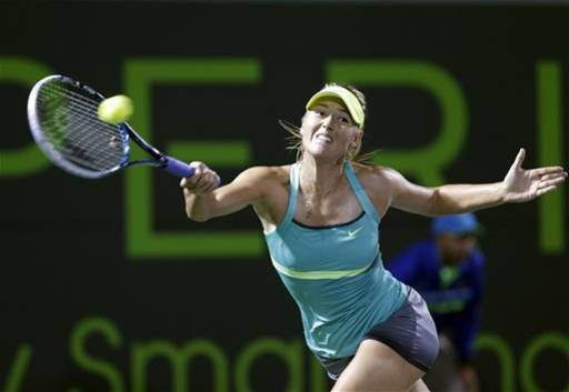 Maria Sharapova, of Russia, returns a shot from Eugenie Bouchard, of Canada, during the Sony Open tennis tournament, Friday, March 22, 2013, in Key Biscayne, Fla