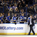 St. Louis Blues' Martin Brodeur waves to the crowd as he walks off the ice after dropping a ceremonial puck before the start of an NHL hockey game between the St. Louis Blues and the Nashville Predators Thursday, Jan. 29, 2015, in St. Louis. Brodeur, who