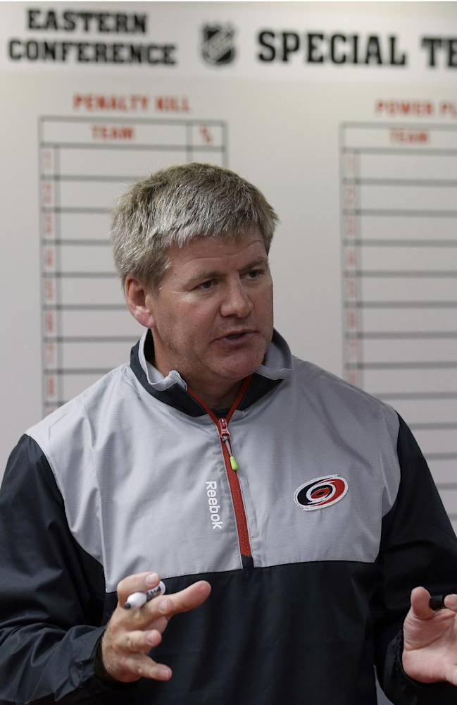 Carolina Hurricanes head coach Bill Peters speaks with members of the media during the team's NHL hockey media day in Raleigh, N.C., Thursday, Sept. 4, 2014