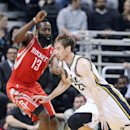 Utah Jazz's Gordon Hayward, right, drives pass Houston Rockets' James Harden (13) in the first half of an NBA basketball game Monday, Dec. 2, 2013, in Salt Lake City. The Jazz won 109-103 The Associated Press