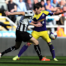 Newcastle United's Mike Williamson, left, vies for the ball with Swansea City's Pablo Hernandez, right, during their English Premier League soccer match at St James' Park, Newcastle, England, Saturday, April 19, 2014