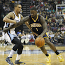 Indiana Pacers guard Lance Stephenson (1) drives against Memphis Grizzlies forward Courtney Lee, left, in the second half of an NBA basketball game on Saturday, March 22, 2014, in Memphis, Tenn. The Grizzlies won 82-71 The Associated Press