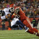 Denver Broncos wide receiver Emmanuel Sanders is tackled by Kansas City Chiefs outside linebacker Justin Houston (50) in the first half of an NFL football game in Kansas City, Mo., Sunday, Nov. 30, 2014 The Associated Press