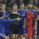 Chelsea players remonstrate with referee Bjorn Kuipers just before he showed a red card to PSG's Zlatan Ibrahimovic during the Champions League round of 16 second leg soccer match between Chelsea and Paris Saint Germain at Stamford Bridge stadium in Londo