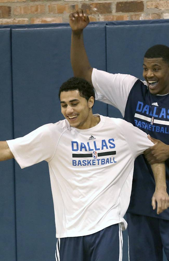 Dallas Mavericks' Ricky Ledo, right, and Rodrigue Beaubois play around at the end of team practice during NBA basketball training camp Thursday, Oct. 3, 2013, in Dallas