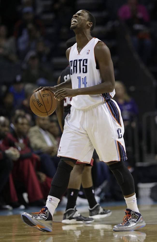 Charlotte Bobcats' Michael Kidd-Gilchrist (14) reacts after being called for a foul during the first half of an NBA basketball game against the Miami Heat in Charlotte, N.C., Saturday, Nov. 16, 2013