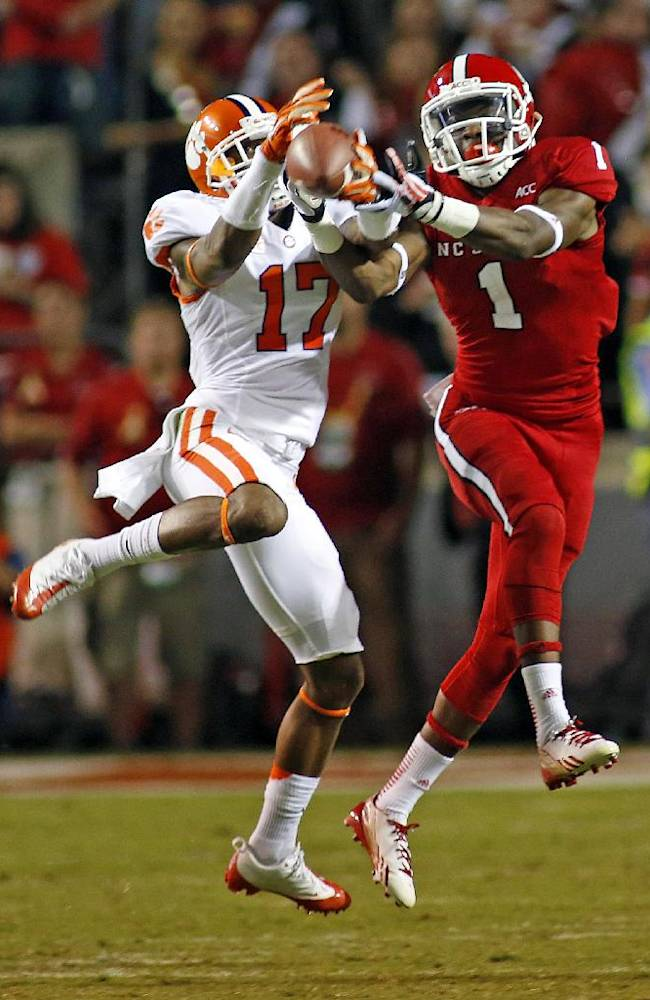 Clemson's Bashaud Breeland (17) breaks up a pass intended for North Carolina State's Marquez Valdes-Scantling (1) during the second half of an NCAA college football game in Raleigh, N.C., Thursday, Sept. 19, 2013. Clemson won 26-14