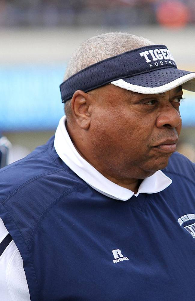 In this Oct. 19, 2013, file photograph Jackson State head coach Rick Comegy  watches as his team runs drills during an NCAA college football scrimmage in Jackson, Miss., after Grambling's football players refused to travel to Jackson State for a football game in October because of issues with their coaches and administration. Jackson State fired Comegy on Wednesday, Dec. 18, 2013, after eight seasons. The university's spokesman said the firing was not completely based on his record, but a combination of factors