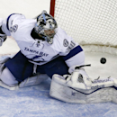 Tampa Bay Lightning goalie Ben Bishop (30) watches the puck slip by him into the net for a goal by Boston Bruins left wing Brad Marchand during the first period of an NHL hockey game in Boston, Tuesday, Jan. 13, 2015 The Associated Press