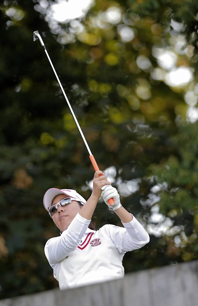 Mika Miyazato, of Japan, plays on the 2nd hole during the second round of the Evian Championship women's golf tournament in Evian, eastern France, Saturday, Sept. 14, 2013