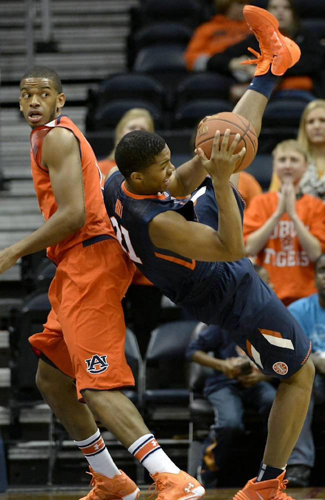 Illinois guard Malcolm Hill (21) brings down the rebound behind Auburn forward Allen Payne, left, in the first half of an NCAA college basketball game on Sunday, Dec. 8, 2013, in Atlanta