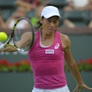 Francesca Schiavone, of Italy, returns a shot against Mona Barthel, of Germany, during a first round match at the BNP Paribas Open tennis tournament, Thursday, March 6, 2014, in Indian Wells, Calif. (AP Photo/Mark J. Terrill)