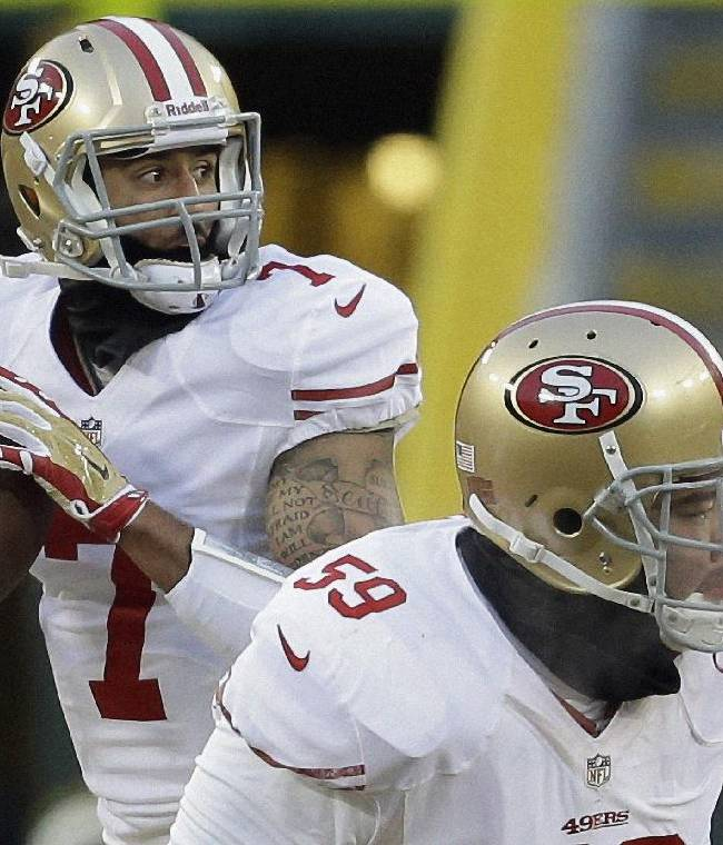 San Francisco 49ers quarterback Colin Kaepernick (7) looks for a receiver during the first half of an NFL wild-card playoff football game against the Green Bay Packers, Sunday, Jan. 5, 2014, in Green Bay, Wis