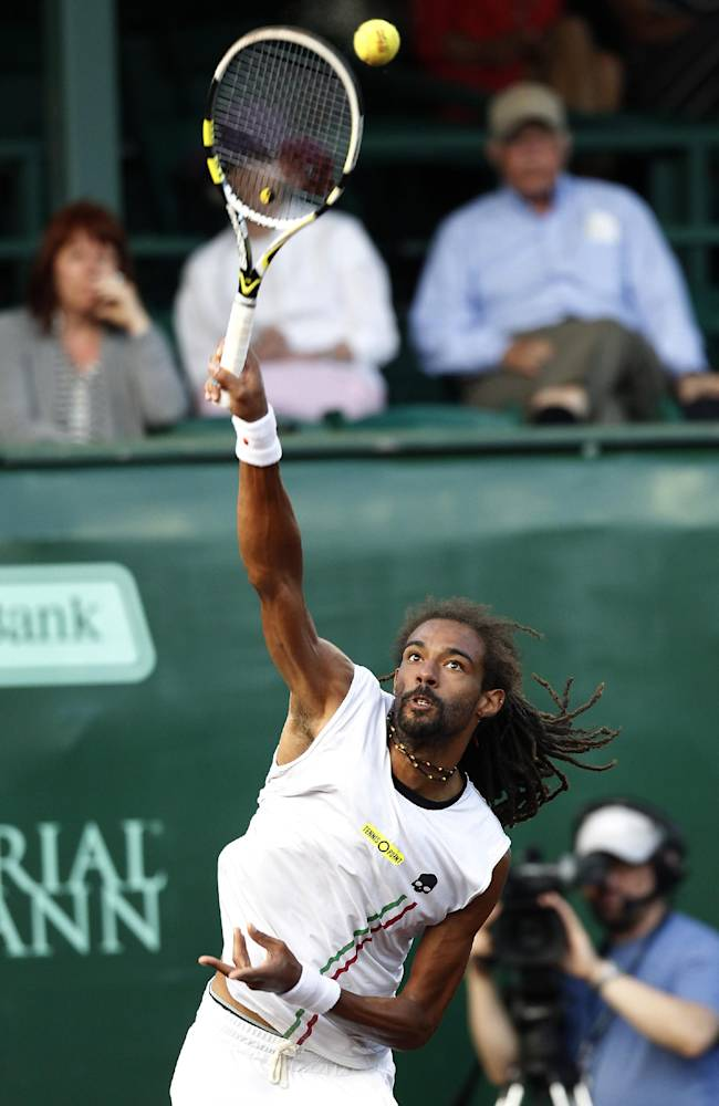 Dustin Brown, of Germany, serves to Sam Querrey, of the United States, in the first set on Friday, April 11, 2014, at the U.S. Men's Clay Court Championship at River Oaks in Houston. Querrey won 6-3, 6-7 (8), 6-3