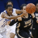 Tulsa guard Taleya Mayberry (12) and Central Florida guard Briahanna Jackson (23) chase a loose ball in the first half of an NCAA college basketball game for the Conference USA women's tournament title in Tulsa, Okla., Saturday, March 16, 2013. (AP Photo/Sue Ogrocki)