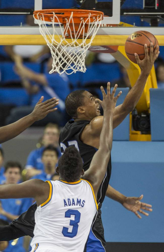 Cal State San Bernardino's Joshua Gouch, top,goes up against UCLA's Jordan Adams (3) in the second half of an NCAA college exhibition  basketball game on Wednesday, Oct. 30, 2013, in Los Angeles