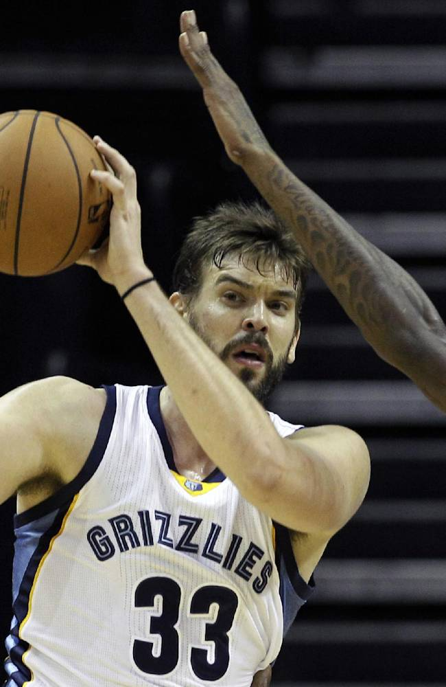 Milwaukee Bucks' Larry Sanders, right, defends against Memphis Grizzlies' Marc Gasol, of Spain, during the first half of an NBA preseason basketball game in Memphis, Tenn., Tuesday, Oct. 15, 2013