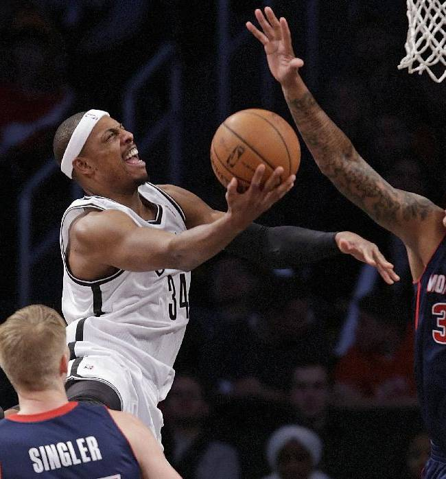 Detroit Pistons forward Charlie Villanueva (31) defends as Brooklyn Nets forward Paul Pierce (34) goes up for a layup in the second half of an NBA basketball game, Sunday, Nov. 24, 2013, in New York. The Pistons won 109-97