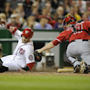 Washington Nationals' Bryce Harper, left, is tagged out at home by Los Angeles Angels catcher Chris Iannetta, right, during the fourth inning of a baseball game, Monday, April 21, 2014, in Washington The Associated Press