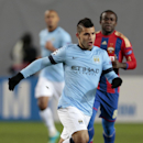 Manchester City's Sergio Aguero, left, in action during the Champions League Group E soccer match between CSKA Moscow and Manchester City at Arena Khimki stadium in Moscow, Russia, Tuesday Oct. 21, 2014