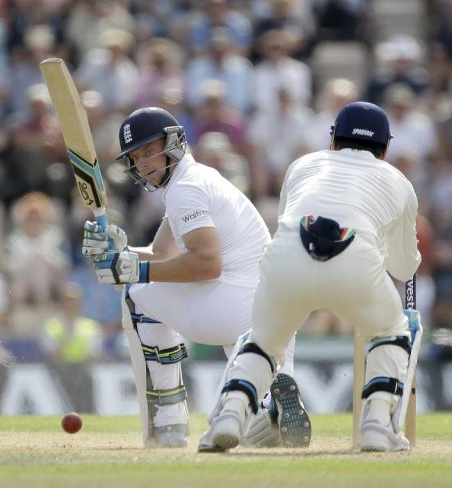 England's Jos Buttler, left, hits a shot during the second day of the third cricket Test match of the series between England and India at The Ageas Bowl in Southampton, England, Monday, July 28, 2014