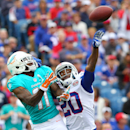 In this Sept. 14, 2014, file photo, Buffalo Bills cornerback Corey Graham (20) breaks up a pass intended for Miami Dolphins wide receiver Mike Wallace (11) during the first half of an NFL football game in Orchard Park, N.Y. The Dolphins are still having
