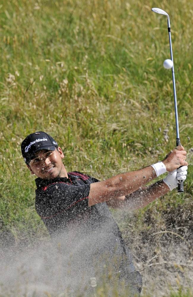 Jason Day of Australia hits out of a bunker on the 15th hole during the final round of the World Cup of Golf at Royal Melbourne Golf Course in Australia, Sunday, Nov. 24, 2013