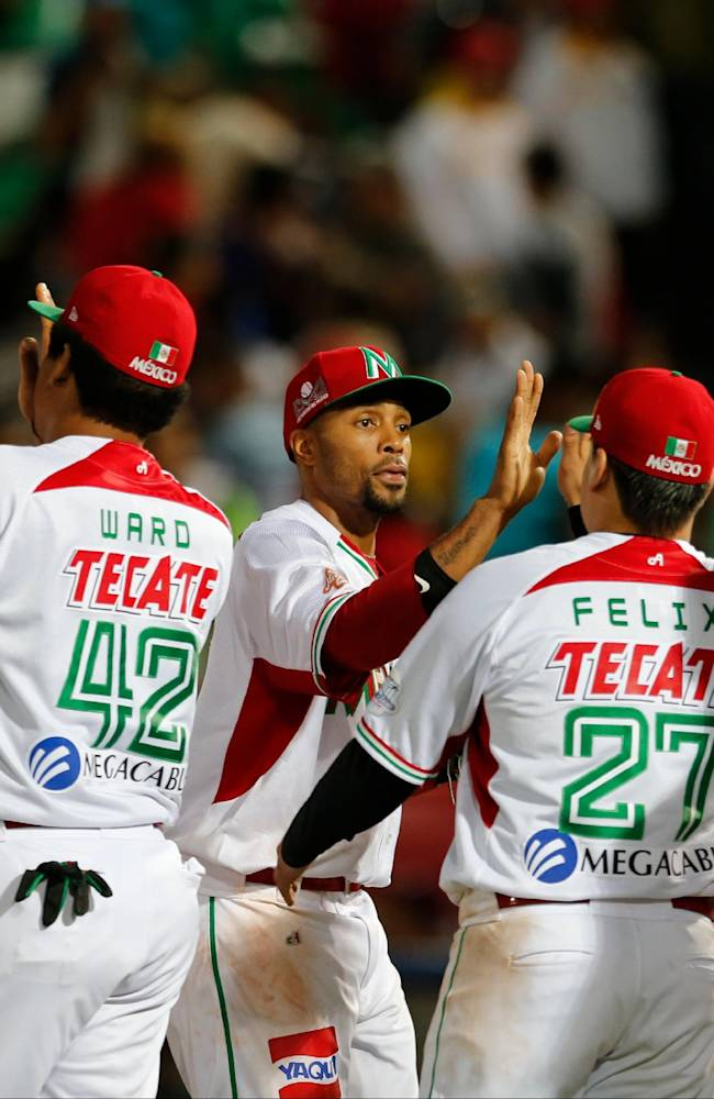 Mexico's players celebrate after they defeated Cuba 9-4 during a Caribbean Series baseball game in Porlamar, Venezuela, Sunday, Feb. 2, 2014