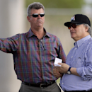 Miami Marlins general manager Dan Jennings, left, talks with Marlins owner Jeffrey Loria during spring training baseball practice, Thursday, Feb. 20, 2014, in Jupiter, Fla The Associated Press