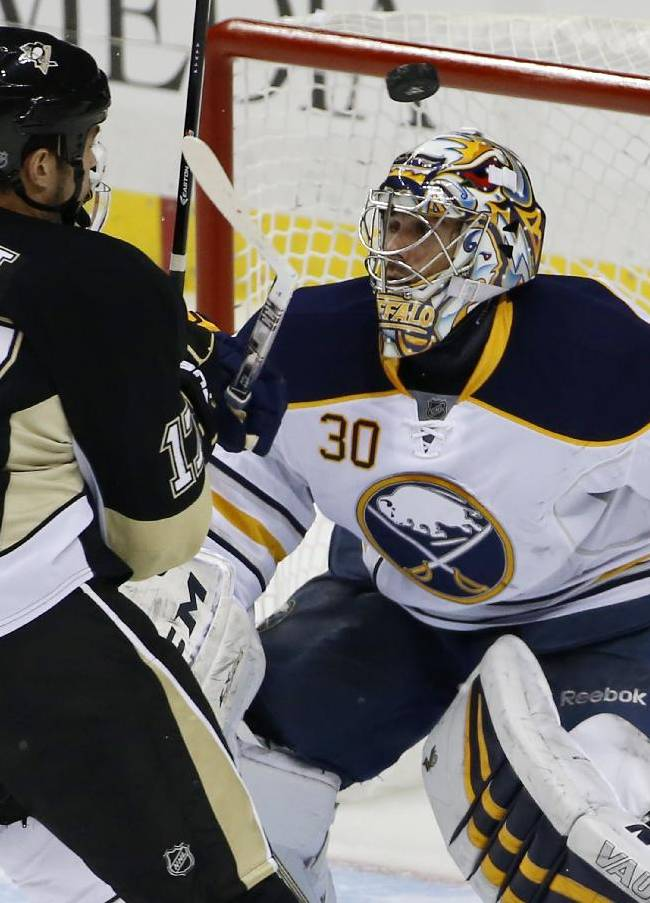 Pittsburgh Penguins' Taylor Pyatt (17) keeps his eye on a rebound off Buffalo Sabres goalie Ryan Miller (30) in the first period of an NHL hockey game in Pittsburgh, Monday, Jan. 27, 2014