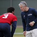 Seattle Seahawks' head coach Pete Carroll talks with quarterback Russell Wilson (3) during a team practice for NFL Super Bowl XLIX football game, Wednesday, Jan. 28, 2015, in Tempe, Ariz. The Seahawks play the New England Patriots in Super Bowl XLIX on Su