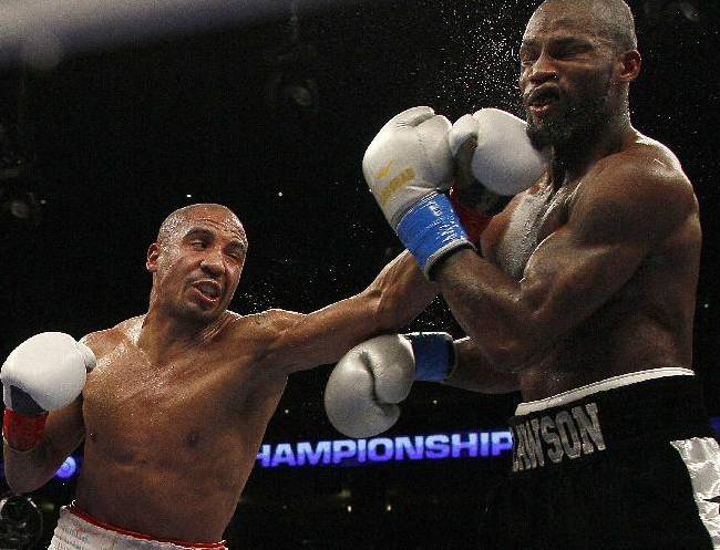 In this Sept. 8, 2012, file photo, Andre Ward, left, punches Chad Dawson during the sixth round of a WBA/WBC super middleweight championship boxing match in Oakland, Calif. Ward has been out of the ring for 14 months, beset by injuries, a spat with his promoter and the inability to find a suitable opponent. The unbeaten super middleweight star returns Saturday against unbeaten Edwin Rodriguez with his eye on bigger fights in 2014