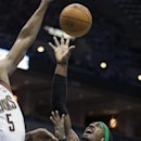 Milwaukee Bucks' Ekpe Udoh tries to block the shot of Boston Celtics' Gerald Wallace during the first half of an NBA basketball game, Monday, Feb. 10, 2014, in Milwaukee The Associated Press