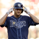 Tampa Bay Rays' Alex Cobb gestures as he looks into the dugout after hitting an RBI-double during the second inning of a baseball game against the St. Louis Cardinals, Wednesday, July 23, 2014, in St. Louis. (AP Photo/Jeff Roberson)