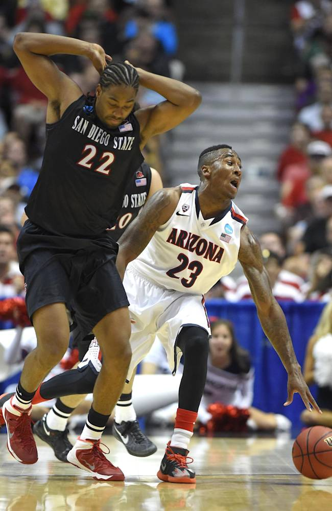 Arizona forward Rondae Hollis-Jefferson (23) is fouled by San Diego State forward Josh Davis (22) during the first half in a regional semifinal of the NCAA men's college basketball tournament, Thursday, March 27, 2014, in Anaheim, Calif