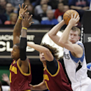 Minnesota Timberwolves' Robbie Hummel, right, of Spain, beats Cleveland Cavaliers' C.J. Miles, left, and Anderson Varejao, center, of Brazil, to a rebound in the first quarter of an NBA basketball game Wednesday, Nov. 13, 2013, in Minneapolis The Associat